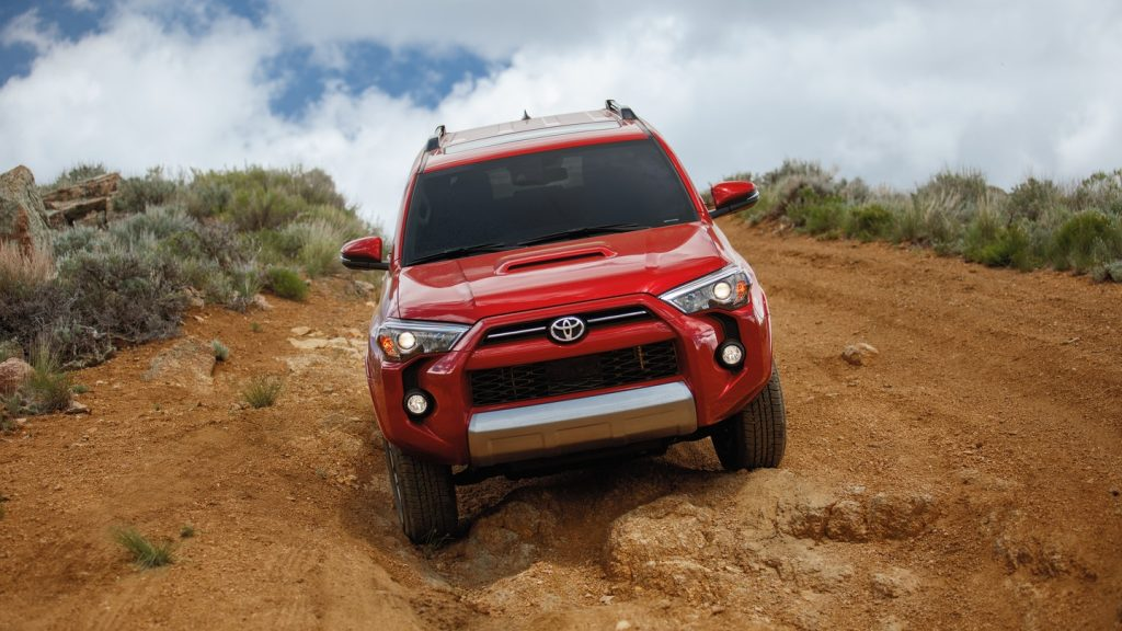 Red 2020 Toyota 4Runner driving off-road in the desert
