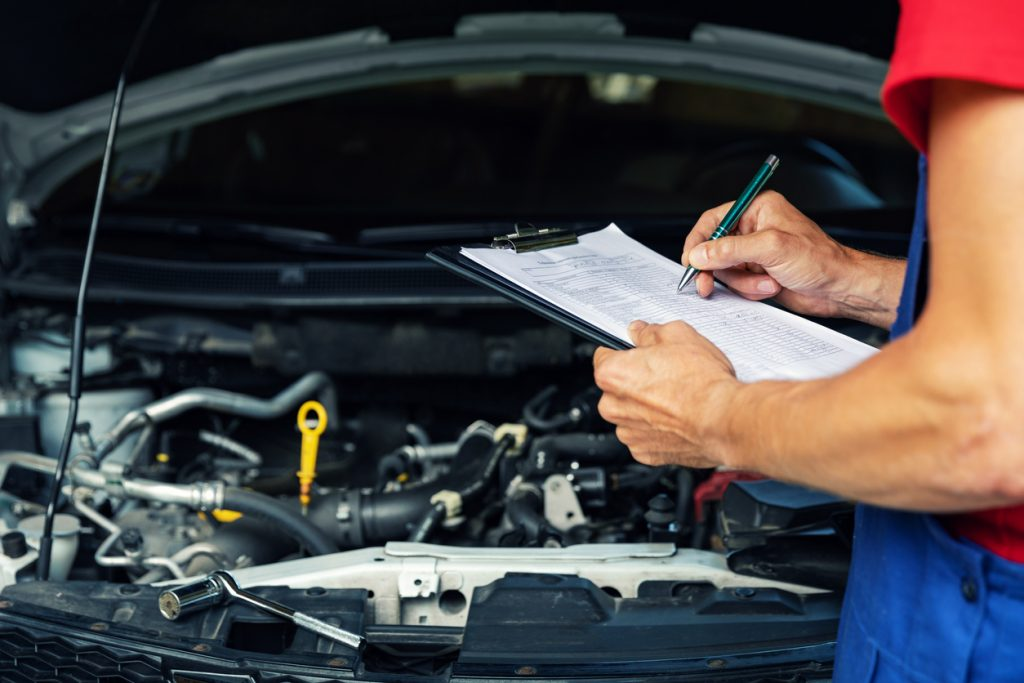Mechanic performing a service on a vehicle