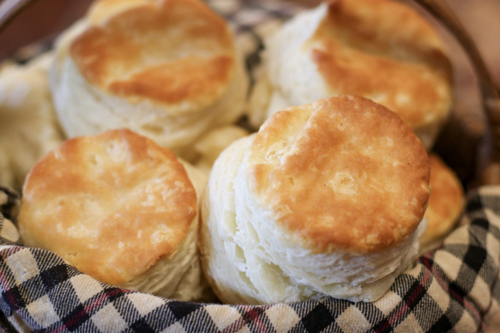 Selective focus closeup of a basket of fresh homemade buttermilk biscuits
