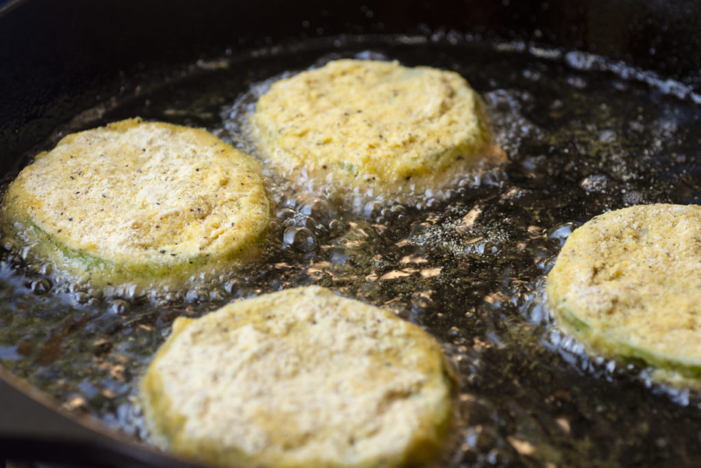 Fried Green Tomatoes Cooking in a Cast Iron Skillet