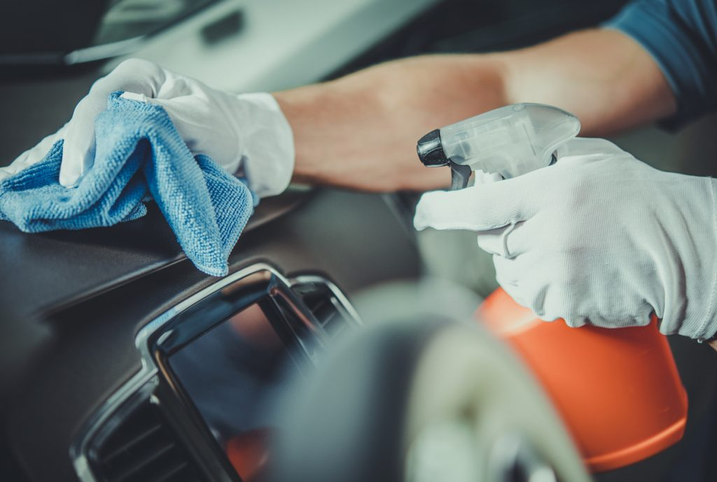 Person cleaning the interior of their vehicle.