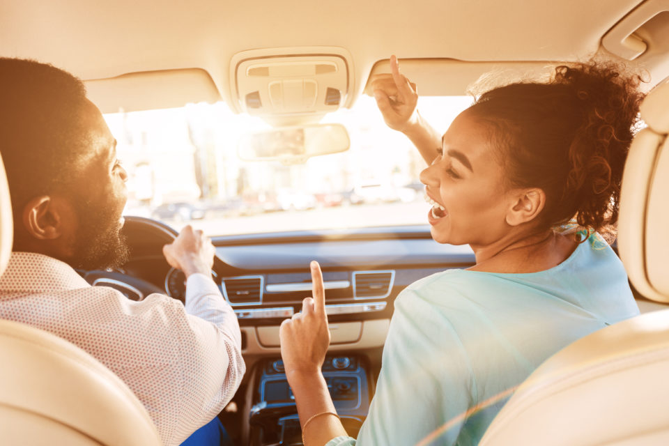 Couple listening to music while driving a car