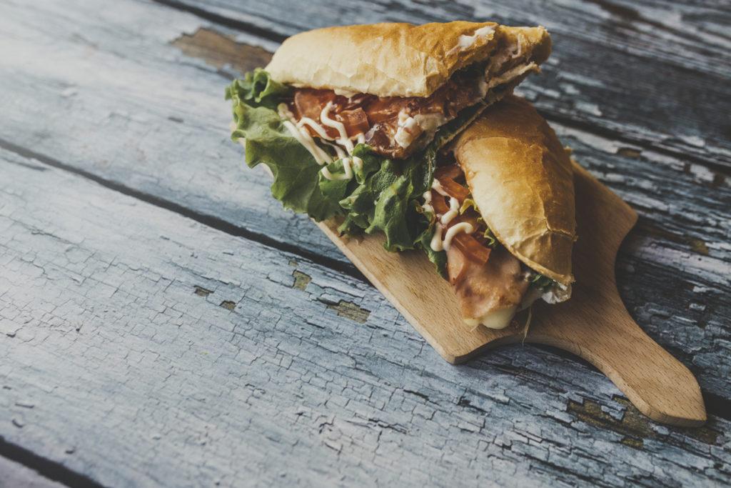 Delicious sandwich on cutting board.