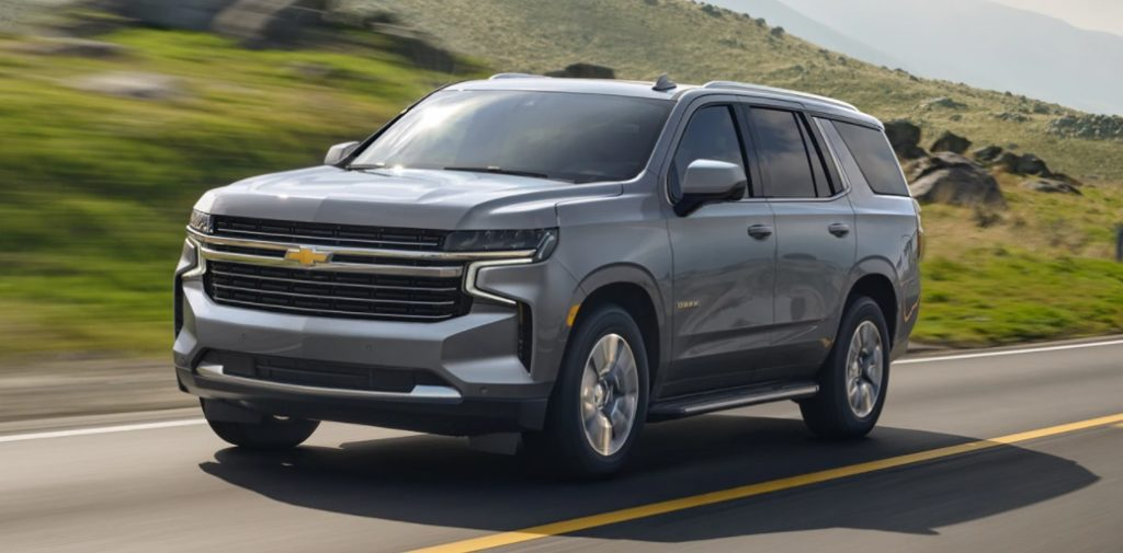 Chevy Tahoe on the road with a background of motion-blurred hills