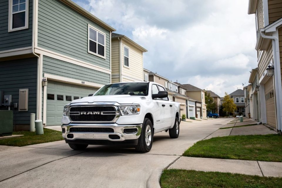 white RAM truck parked in neighborhood