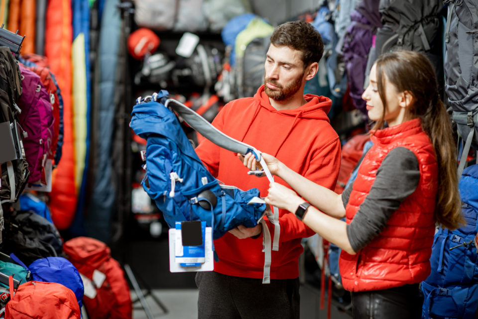 Couple looking on the sports equipment in the shop
