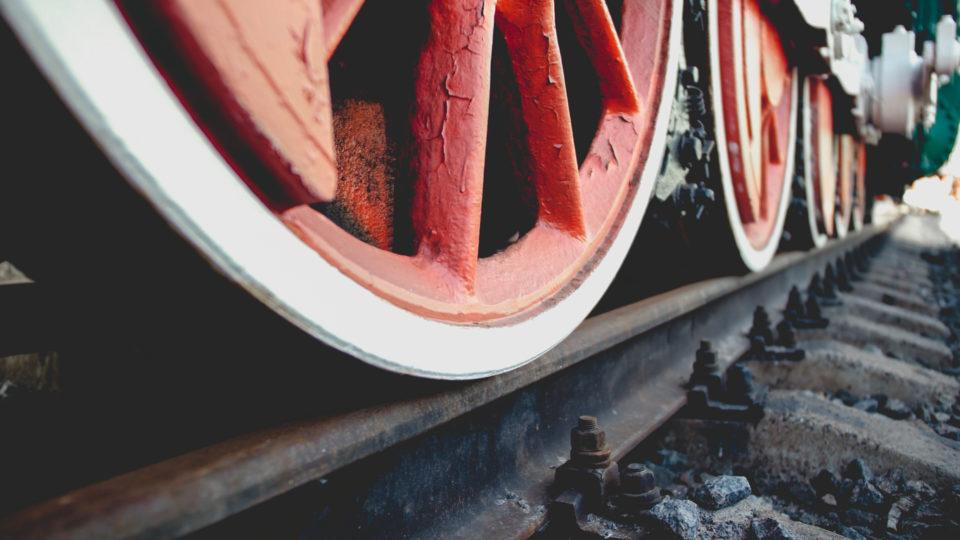 Closeup toned photo of vintage steam train locomotive on railroad station