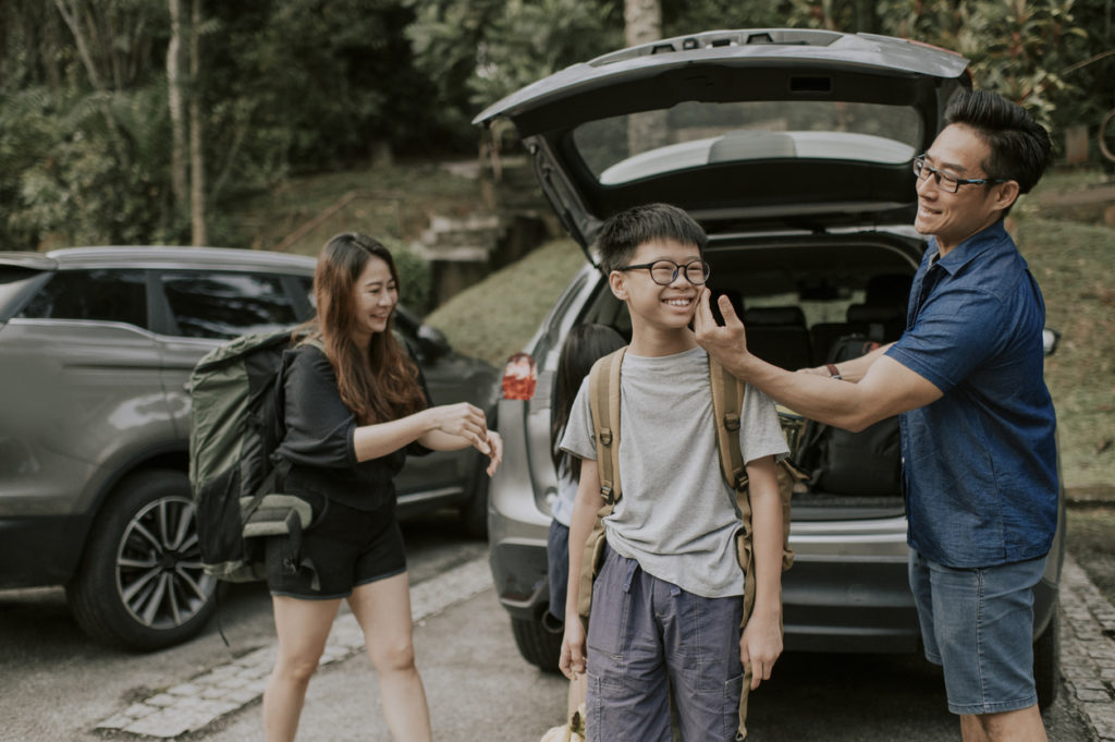 Family loading the car for a road trip