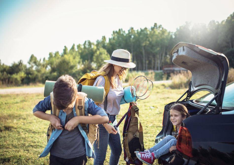 Happy Family Enjoying picnic and Camping